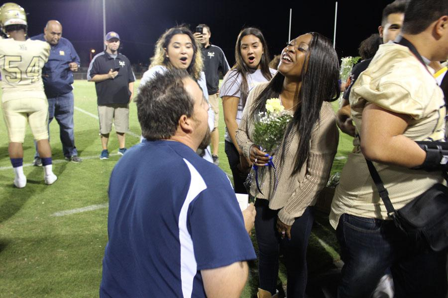 Coach McDaniel surprises girlfriend Monique Bygrave with an engagement ring before the home game against Vista Del Lago on November 4. McDaniel recruited some of his friends and students to help with surprising Bygrave, his girlfriend of eight years, with a proposal.